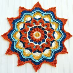 """Mandela Mandala! It's written for DK yarn but I did mine in worsted weight and have a lovely 22"""" wide centerpiece! You can find the pattern here: http://www.ravelry.com/patterns/library/mandela-mandala"""