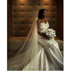 Our stunning August bride Gifty in her luxe satin Swarovski crystal embellished fishtail gown and her cathedral length crystal embellished veil.  Ive never met someone as bubbly as Gifty, she was so energetic from the very beginning to the final collection day! -Gbemi.x  We love being part of your wedding experience.  #alonuko #bridal #wedding #weddingdress #weddinggown #bride #bridetobe #style #fashion #bespoke #beautiful #weddingday #fishtail  by @adebayoderu