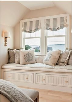Pretty relaxed roman shade in window seat. Coastal Interior window seat in the bedroom. What I like about window seats is that they are appealing, are an added feature to any room, a nook and also storage. The window seat wears many hats! Interior Windows, Bedroom Windows, Bay Windows, Bedroom Blinds, Blinds Curtains, Window Blinds, Privacy Blinds, Blinds Diy, Grey Blinds