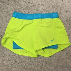 Nike running shorts with spandex Blue and green Nike running shorts with spandex underneath. Super comfortable! Like new! Nike Shorts