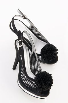 Sandals crafted in PU, featuring a peep toe, a low cut vamp with mesh panel to the side, fluffy pom-pom detail to front, a sling back strap with pin buckle fastening, contrast color platform and a tapered high heel.