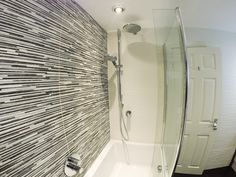 These Porcelanosa Jersey Mix tiles coupled with a Jersey Nieve tile create a great 3d look to the bathroom