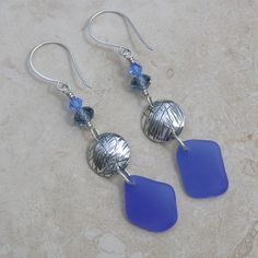 Amphitrite Dreams Upon The Sea Earrings with beautiful cobalt blue sea glass that we collected on beaches in the Caribbean.