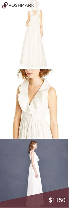 "Discontinued! J. Crew Wedding Dress J. Crew Bridal- ""Kira"" Ivory Wedding Dress. Gorgeous ivory taffeta gown with a tulle underlay for added volume. Ruffled collar accents the simple elegance of this dress. J. Crew bridal items are highly coveted since the entire bridal line has been discontinued. Comes in garment bag. Brand new with tags; offers considered. (No bad energy attached! Bride is still happily married, just picked a different dress last minute.) Sale is final. J. Crew Dresses…"