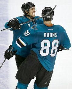 San Jose Sharks defensemen Brenden Dillon and Brent Burns celebrate Burns' goal (Dec. 9, 2014).