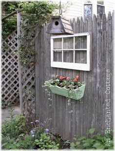 Old window and flower box on a fence.  This could go on our fence near new barn addition.
