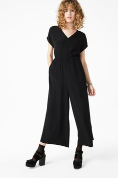 Made for moving (and grooving when required), this wide fitting cap sleeve jumpsuit is so versatile it can be used for any occassion! Includes handy side pockets, a deep V-neckline, gathered waistline and a hidden zip at the back.
