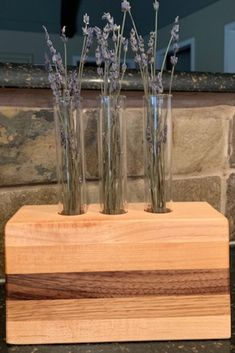 We love our handcrafted wood desktop planter made from walnut, cherry, & maple. This planter includes 3 test tubes, allowing you to change the look often. Commercial Planters, Stone Planters, Fresh Flowers, Wood Furniture, Indoor Plants, Glass Vase, Modern Design, Lavender, Desktop