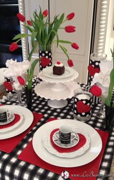 Black, White and Red Tulips set the scene for an easy table setting. White dinner ware, cake stands and Black Forest Mini Cakes for the Dessert Centerpiece. Valentines Day Decorations, Valentines Diy, Valentine Table Decor, Decoration Table, Table Centerpieces, Centrepieces, Beautiful Table Settings, Red Tulips, Holiday Tables
