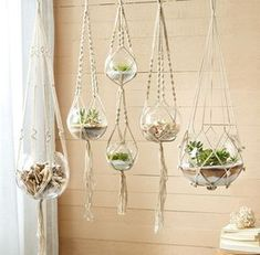 Whether you are seeking a boho maximalist jungalow look, or if you crave the more minimal impact of a solitary succulent hanging in your window, our 100% cotton, braided macramé plant hangers will bri