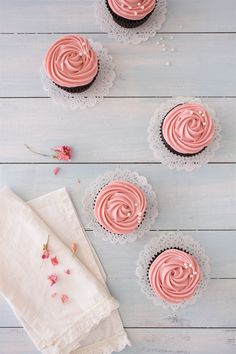 Double Chocolate Cupcakes with Strawberry Cream Cheese Frosting - incredibly tender and chocolatey cupcakes topped with roses of creamy strawberry frosting. A perfect Valentine's Day dessert! | www.brighteyedbaker.com