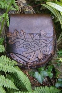 Belt pouch with carved oak leaf and acorn strap