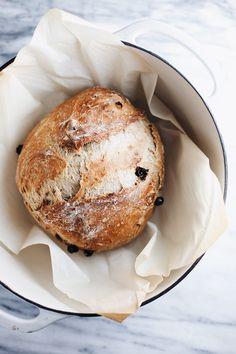 Cinnamon Raisin Artisan Bread - an airy, lightly crispy crust, and a doughy slightly sweet inside. So yummy and easy! | asimplepalate.com #breadrecipe #cinnamonraisinrecipe #bakingrecipe