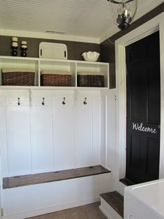 mudroom in garage...love the welcome on the door.