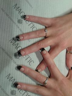 Elegantly Black French Tips with glitter