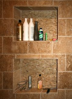 """little nooks in the shower/bathtub, but big and deep enough for the """"family"""" size bottles. Future home :) LOVE THIS"""
