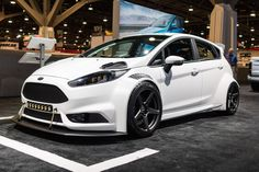Do you prefer your sports cars to be light and agile? Tucci Hot Rods won a coveted Ford Design Award, at the 2016 SEMA Show, with their widebody Ford Fiesta ST! This wild ride is powered by Ford's lightweight 1.6L EcoBoost engine and rides on 18x10 Forgeline one piece forged monoblock CF1R wheels finished in Matte Graphite! See more at: http://www.forgeline.com/customer_gallery_view.php?cvk=1785 #SEMAShow #FiestaST #Forgeline