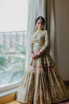 Looking for Silver bridal lehenga with peplum and full sleeved blouse? Browse of latest bridal photos, lehenga & jewelry designs, decor ideas, etc. on WedMeGood Gallery. Desi Wedding Dresses, Pakistani Wedding Outfits, Indian Bridal Outfits, Bride Dresses, Wedding Hijab, Indian Dresses, Indian Bridal Lehenga, Pakistani Wedding Dresses, Western Lehenga