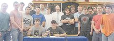 LVISD Surrounded by their friends and Bear teammates, Nick Simpson (seated, l-r) and Justus Parker of La Vernia High School are thrilled to become two of the newest members of the Texas Lutheran University (TLU) football team. The athletes and friends recently signed their letters of intent to TLU, and will be roommates on campus.
