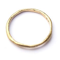 This tiny, softly textured organic ring is perfect for stacking or wearing by itself. About 2mm wide.