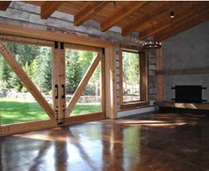 barn doors & concrete floor...LOVE. also love the weathered wood on the walls. awesome for sliding glass doors