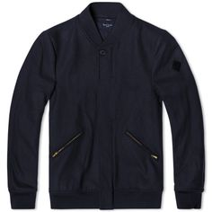 The Melton Bomber Jacket from the Paul Smith collection for AW14 is the somewhat eccentric British designer's take on the classic overshirt design. Constructed with a wool blend shell, it is kitted out with a generously sized chest pockets and a full covered placket. A refined version of a traditional design, it is finished off with a leather logo patch.  Wool Blend Shell Spread Collar Button Closure Chest Pockets Logo Patch