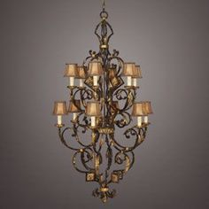 Fine Art Lamps Castile 234040ST Two tier, twelve light chandelier in warm antiqued and gold leaf finish. Hand sewn silk shades with braided trim.