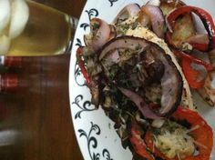 Tonight's dinner was taken from a picture of my friend's lunch at Applebee's(minus zucchini cuz I don't know how to prepare it).  Baked Chicken Breast topped with Baby Portabella's, Onions and Parmesan served on Sautéed Red Peppers, Red Onions, Mushrooms and Crispy Red Potatoes with Green Tea.