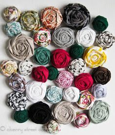 Cherry Street Cottage: Fabric Flower Tutorial - rolled rosettes with strips of fabric and a glue gun.
