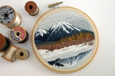 Hand embroidered and framed in a 5 wooden hoop, this peaceful scene is stitched onto a lovely tan cotton. This impressionist landscape would