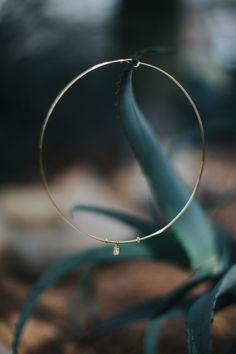 yellow diamond collar necklace, bezel set with one radiant-cut Forevermark diamond