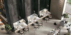 Suurlaatat vangitsevat katseen│Laattapiste #suurlaatta #tumma #kahvila #ravintola #sisustus #slab #café