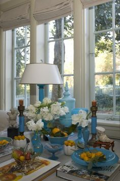 Christy Ford groups her collection of blue opaline glass for a striking seasonal display in the living room.
