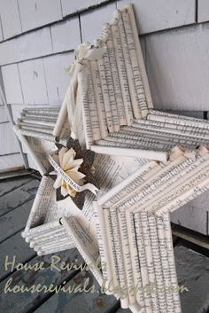 House Revivals: New Star Design from Vintage Book pages. Three-dimensional star made from rolled sheets of vintage paper.