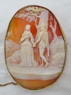 Cameo brooch depicting Maid Marian and Robin Hood. mounted in 9k gold frame