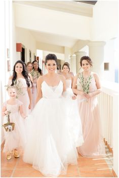 bride with her bridesmaids wedding party portraits getting ready