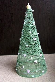 cone shape for pattern, yarn, glue and some little stars. I am all over this for Christmas decorations.