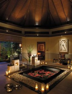 A truly romantic or relaxing setting for two or for one to relax and read a great book.  The design of this room is beautiful, I would have a gold tub instead of black, lighten up the room with vibrant colors and keep the same designed style. -- Yes, romance is in the air........