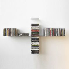 Wall-mounted shelf / contemporary / steel / for CDs TUS TEEbooks