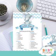 Set the stage for a fun celebration with these Blue Elephant Baby Shower Games. The elephant themed baby shower games feature an adorable baby boy elephant sitting on top of a vintage ribbon banner against a white backdrop decorated with a chevron zigzag pattern in blue. #babyshower #babyshowergames #babyshowerideas #babyshowerpartyideas