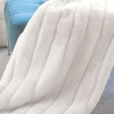 Handcrafted faux mink fur throw in winter white with a velvet lining.  Product: ThrowConstruction Material: AcrylicColor: Winter whiteFeatures:  HandcraftedVelvet lined  Cleaning and Care: No heat.  Air cycle only.