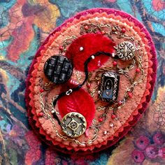 Wool felt brooch with scarlet red velvet leaves, vintage buttons and embroidery. $50.00, via Etsy.