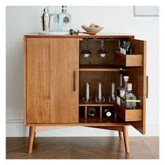 West Elm Mid-Century Bar Cabinet - Small, Acorn ($799) ❤ liked on Polyvore featuring home, furniture, storage & shelves, bar cabinets, home storage furniture, door furniture, mid century modern bar cabinet, mid century bar cabinet and acorn furniture