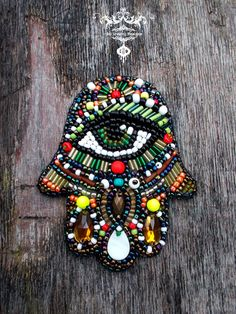 Hamsa hand of fatima bead embroidery by AniDandelion on Etsy                                                                                                                                                                                 More