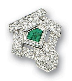 EMERALD AND DIAMOND BROOCH / PENDANT / CLIP.  Of Art Deco design, the symmetrical plaque centring on a cut-cornered triangle emerald weighing approximately 3.00 carats, edged by baguette diamonds, the plaque encrusted throughout with brilliant-cut diamonds, the diamonds together weighing approximately 3.60 carats, mounted in platinum, brooch, pendant and clip fittings.