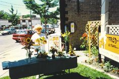 Floral design demos outside during MItton Village Sidewalk Sale Days...