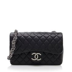 This highly-coveted Chanel bag is made from quilted black lambskin with a pearl-studded CC logo and ruthenium hardware. Details include a twisted chain and pearl strap, magnetic snap closure, and fully lined interior with one zippered pocket.