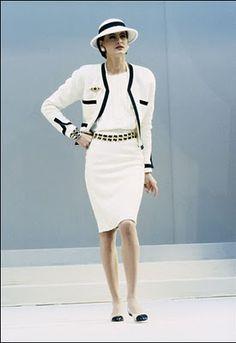 legendary CHANEL model Inès de la Fressange wearing iconic CHANEL suit