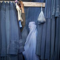In this April 11 2013 photo an Afghan woman waits in a changing room to try out a new Burqa in a shop at in the old city of Kabul Afghanistan. #APPhoto by Anja Niedringhaus  Two years ago Anja Niedringhaus an internationally acclaimed German photographer who worked for The Associated Press was killed when an Afghan policeman opened fire while she and AP correspondent Kathy Gannon were sitting in their car in eastern Afghanistan. We remember Anja by sharing some of her work.  Niedringhaus…