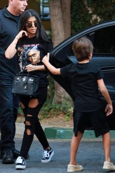 Kourtney Kardashian wearing Hermes Birkin 25cm Black Togo Bag, Tupac All Eyez on Me Tee, Good American Good Legs Black003 Raw Edge Hem Destroyed Skinny Jeans and Vans Old Skool Sneakers